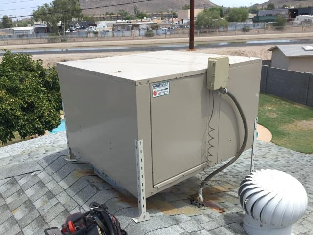 Phoenix, AZ - In Phoenix, AZ:  PREVENTATIVE MAINTENANCE COMBO-  AC System: Cycled system on into cooling mode. Checked volt and amp draws; found run capacitor down on micro farads. Recommend new 55/5/440 capacitor. Indoor coil is very dirty and needs to be acid washed and drain line is broken and leaking on roof. Freon levels look good. Cleaned and tightened electrical connections. Checked splits: Return 74/Supply 55. Installed new capacitor and acid washed the indoor coil. Customer is going to replace drain line.  Evap Cooler: Cleaned out wet section. Oiled motor and pillow bearings. Cleaned the pump basket and set float. Cooler is running properly at this time. Completed services and repair.