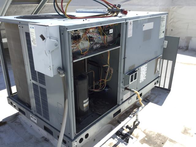 Scottsdale, AZ - In Scottsdale, AZ:  DIAGNOSTIC-  Upon arrival, cycled unit into cooling mode. Found panel to return off of unit causing unit to suck in hot air. Found condensing coils completely restricted. Washed and rinsed outdoor coils. Upon departure, unit is working properly and within manufacturer specifications.