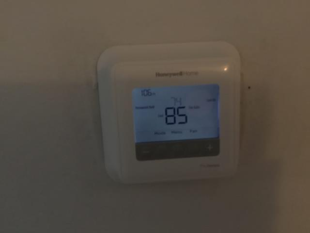 Sun City, AZ - In Sun City, AZ:  DIAGNOSTIC-  On arrival, found system running. Checked Freon and all is in factory specification. Checked volt and amp draws; also in factory specification. Found thermostat is working intermittently if you touch it, it shuts off the system. Installed new Honeywell thermostat; home warranty company to reimburse her. Service complete.