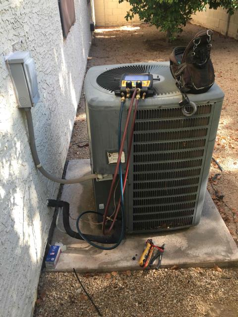 In Tempe, near East Dawn Drive and South Forest Avenue performing a diagnostic on a Goodman compressor. I found that capacitor was out of specifications and outdoor motor was seized. I replaced run capacitor and reconnected to existing hard start kit. Unit is up and running properly upon departure.