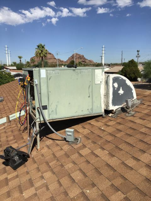 Scottsdale, AZ - In Scottsdale, near East Moreland Street and North 66th Street performing routine seasonal maintenance on a 21 year old Rheem gas pack. I would recommend replacing this unit, as indoor coil is rusted and testing positive for leaks. Blower and fan motor need replacement as well. This unit is still using R22 Freon. I will leave bids with options for replacement with customer.
