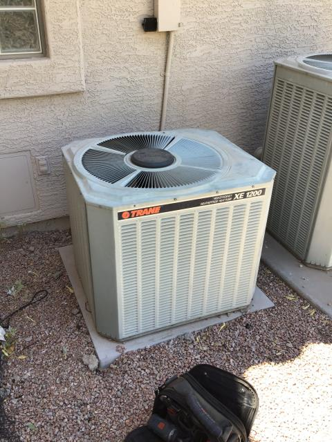 In Mesa, near Signal Butte Floodway and North Vincent Circle performing a diagnostic on a Trane condenser. Fan motor was seized and capacitor swollen upon arrival. Replaced capacitor and motor. Charged system with 3 lbs of R22. Unit is working properly upon departure.