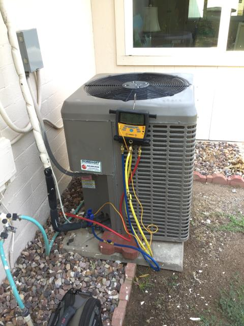 Chandler, AZ - In Chandler, near West Toledo Street and North Comancher Drive performing routine seasonal maintenance on a York condenser. There are multiple leaks on this coil. Need to return with sheet metal and silicone to seal system. Recovered charge.