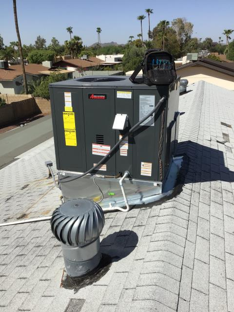 Scottsdale, AZ - In Scottsdale, near East Laurel Lane and North 52nd Street performing a quality inspection on a newly installed 4 ton, 14 seer Amana gas package system. Customer had concerns with air flow. Opened registers in guest bedroom and kitchen. Ducting was not sealed at return correctly. Gas piping on roof poorly done. Installed new fittings and secured. Ran new drain line. Unit is working properly upon departure.