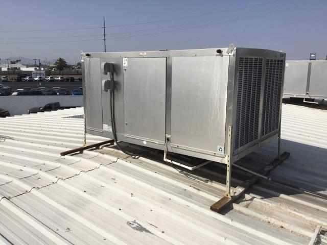 Glendale, AZ - In Glendale, near Grand Avenue and North 53rd Avenue performing a diagnostic on a commercial evap cooler. Upon arrival, found cooler motor sparking and grounded out; needs new cooler motor with new pulley and belt.