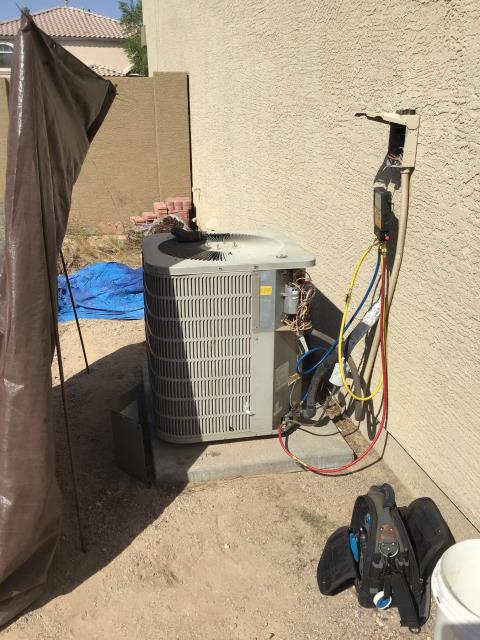 Glendale, AZ - In Glendale, near Hayward Avenue and North 110th Lane performing a diagnostic on a split system. Found wiring to capacitor melted. Mended wires and cycled system. Compressor is high amping and starting to fail.