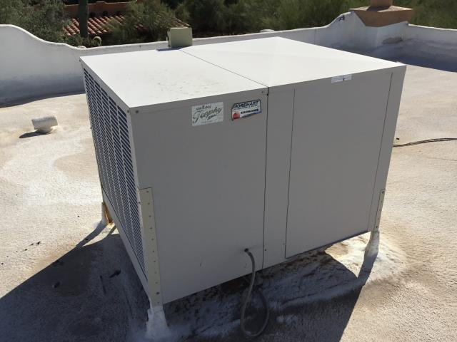 Cave Creek, AZ - In Cave Creek, near East Tapekim Road and North 53rd Place performing  a diagnostic on an evaporative cooler. Upon arrival, found pump not working. Installed new pump and cleaned pump basket. Upon departure, unit is working properly and within manufacturer specifications.