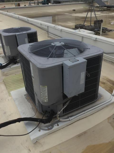 In Phoenix, near West Earll Drive and North Central Avenue performing a diagnostic on a Carrier split system. Upon arrival, kitchen staff stated burned smell in kitchen. Smell could be coming from shorted electrical box. Went up to condensers and made sure units were operational. Recommended washing coils and adding charge to both.