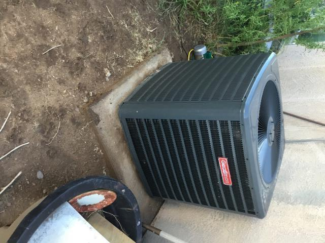Coolidge, AZ - In Coolidge, near West Lincoln Avenue and South Arizona Boulevard performing a diagnostic on a Goodman condenser. Upon arrival, cycled unit into cooling mode. Found intake extremely restricted and upon removing filter, felt hot air coming from ceiling. Insulation needs to be added to attic. Also found no air escaping from attic; highly recommend adding whirly birds. Also recommend adding return air addition to bedroom to take hot air out of room and adding return plenum box.