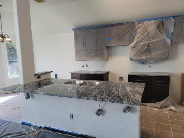 Katy, TX - Whole house restoration coming along beautifully with new cabinets and granite countertops!