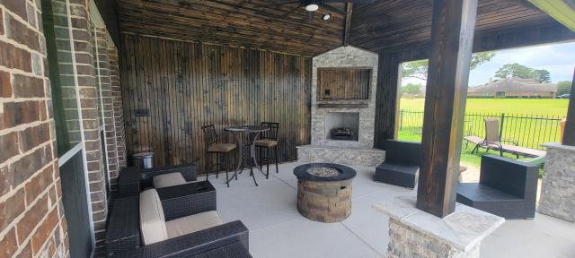 Cypress, TX - Beautiful covered patio with gas fireplace, lights, and fan!
