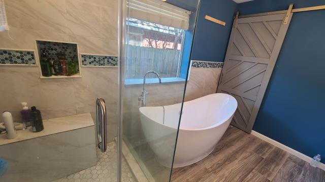 Katy, TX - Post water damage full bathroom renovation.  Bathtub replacement & barndoor installation.