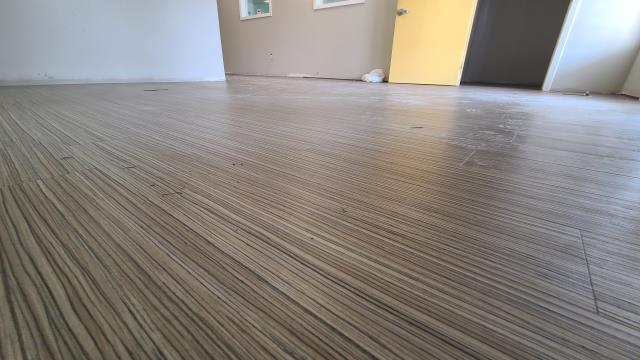 Katy, TX - Post water damage full commercial restoration.  Exterior water proofed, new drywall & vinyl plank flooring installation.  New cabinets and custom reception desk with epoxy countertops.
