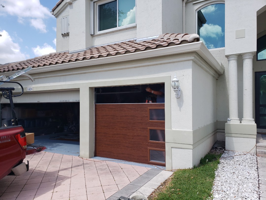 Pembroke Pines, FL - Pembroke Pines high impact garage door replacement, these are Modern Steel doors from Clopay. Aren't they beautiful!! Getting there anyway!