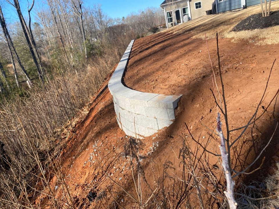 Greer, SC - Installed a 74' long a 3.5 tall retaining wall down hill to enlarge backyard.