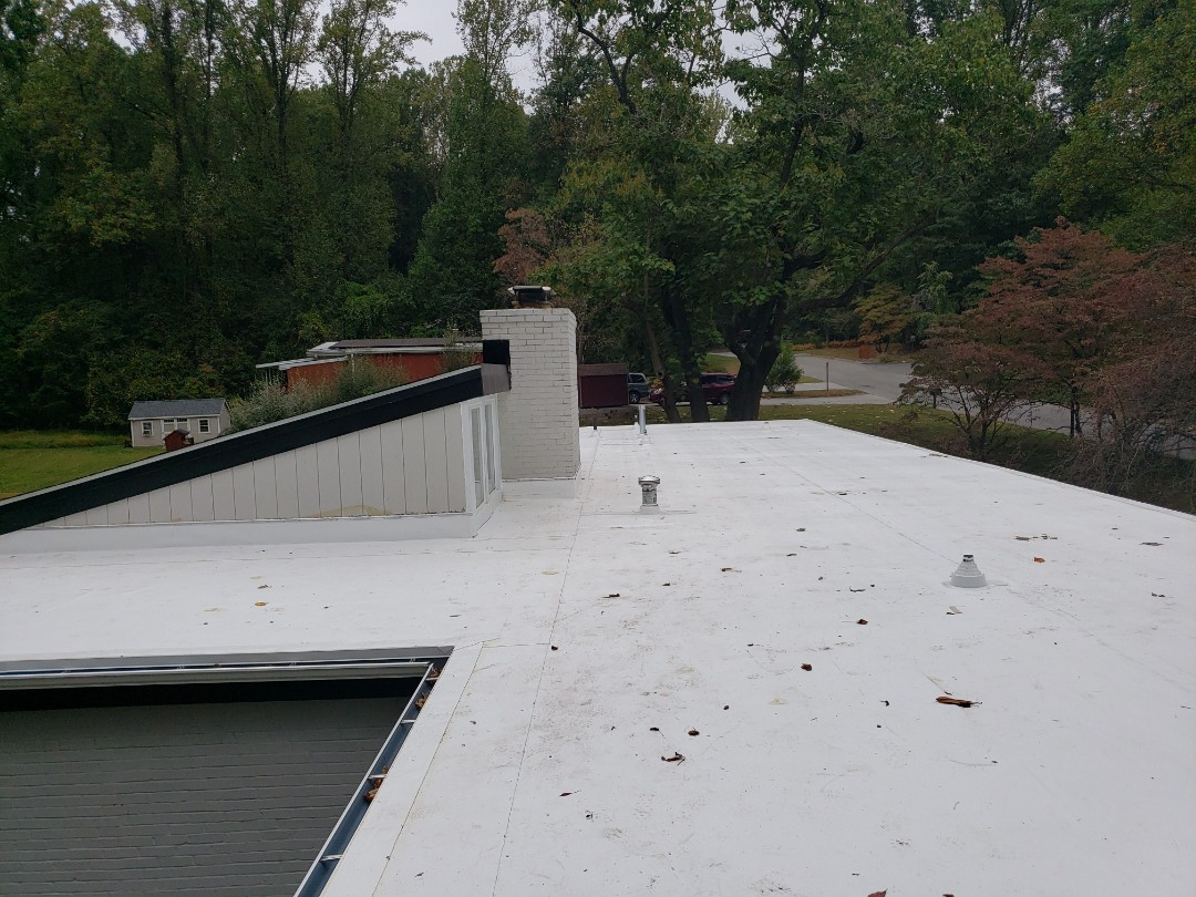 Pikesville, MD - Flat roof , and gutters Replacement.  Roof was leaking really bad.  We removed existing flat roof and gutters and installed new TPO flat roof system and new seamless gutters.