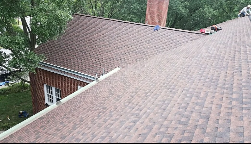Silver Spring, MD - New roof , skylight , gutters downspout and leaf Relief