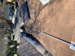 Antioch, CA - Loosened sheet metal from around the a/c unit and installed new shingles underneath. Replaced cracked shingles underneath solar panels in 2 seperate areas.  Furnished and replaced 6 missing shingles.  Sealed all ridge nails.