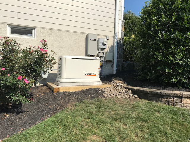 """Glen Mills, PA - New 22kw Generac Generator with 200 AMP smart switch.  The generator was set on 8"""" of crushed stone bordered by 6x6 pressure treated timbers and then set atop a GenPad. This homeowner will never have to worry about loosing power again!"""