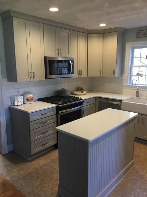 Hampton, VA - Shades of gray.  White and gray cabinetry are very popular.  What color gray works with your design?  BJ Tidwell Cabinetry offers several gray options.  This kitchen shows their Shaker II door in the Silver Gray paint finish.