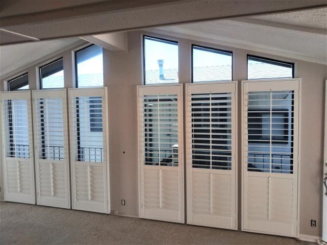 Hemet, CA - Installed shutters throughout the house in Hemet.  These shutters have divider rails allowing the top and lower portions to open separately.