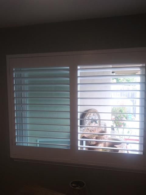 Huntington Beach, CA - Installation of basswood shutters with clear view option