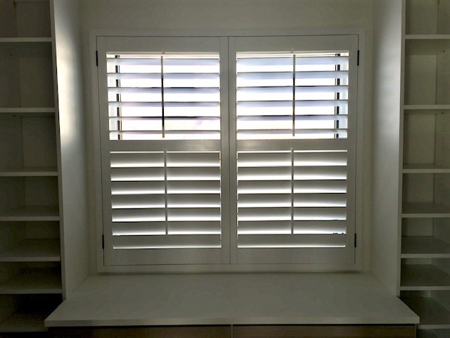 Laguna Beach, CA - Custom painted basswood shutters with black hinges and divider rails. Laguna Beach.