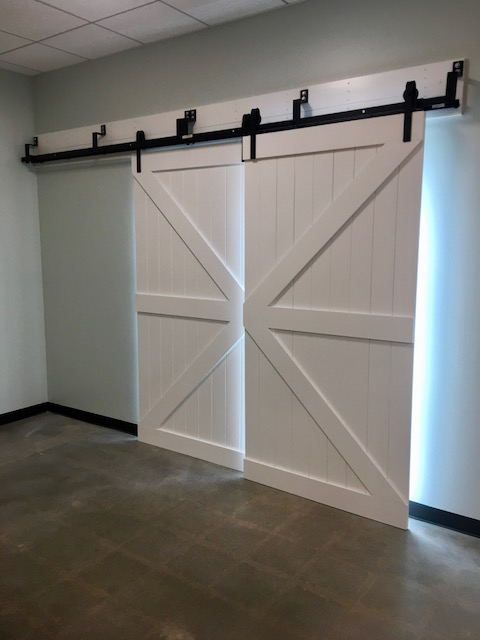 Highland, CA - A beautiful custom barn door made from solid basswood installed at a charter school.