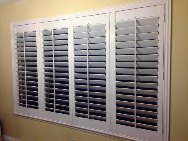 San Bernardino, CA - Poly Shutters with deco frames, 4 panels.