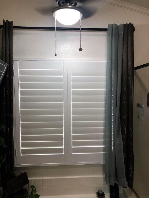 Beaumont, CA - Poly shutters, 2 panels, in a bathroom.