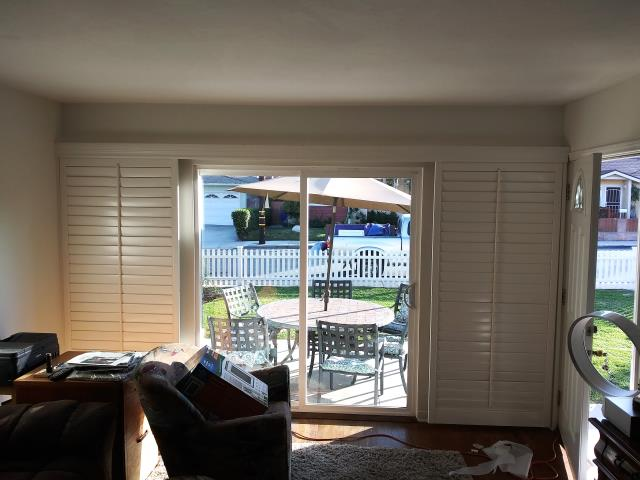 Redondo Beach, CA - Basswood Shutters on a bypass track for sliding glass door.