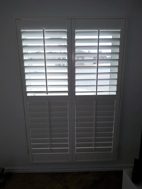 Laguna Beach, CA - Poly shutters with split tilt rod