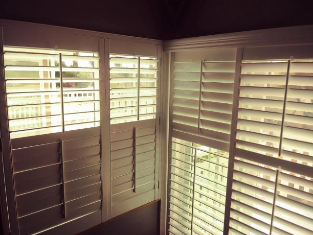 Yorba Linda, CA - Shutters installed on a window and slider, corner group.  Shutters have divider rails.
