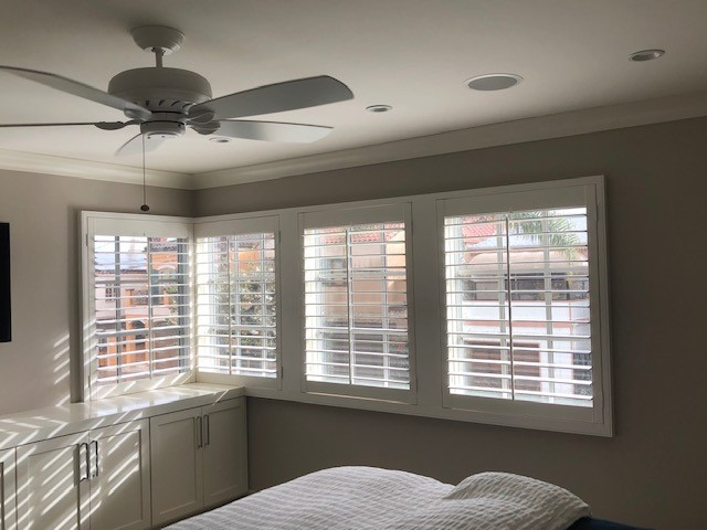 Long Beach, CA - Installed shutters throughout the house. These windows were tricky because there was a cabinet partly obstructing the windows and there was no room for a corner post. But the shutters fit perfectly and look great!
