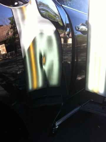 Austin, TX - Fixed dents in right rear door of 2009 black Nissan Maxima.