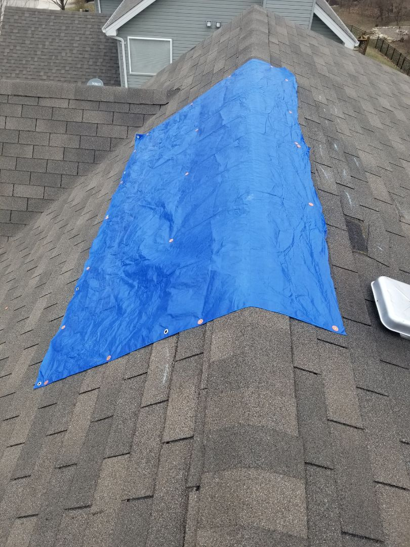 Swansea, IL - Major wind damage repair over the weekend customer has many missing shingles! We tarped the roof for safety and filed a claim for the customer. Call us for emergency tarp services and assistance in filing your claim today!