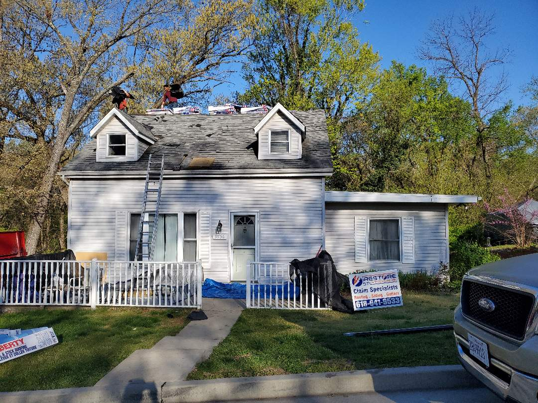 Fairview Heights, IL - Beautiful transformation about to happen from an old 3 tab to a new Timberline HD Z complete roofing system. With Cobra attic ventilation