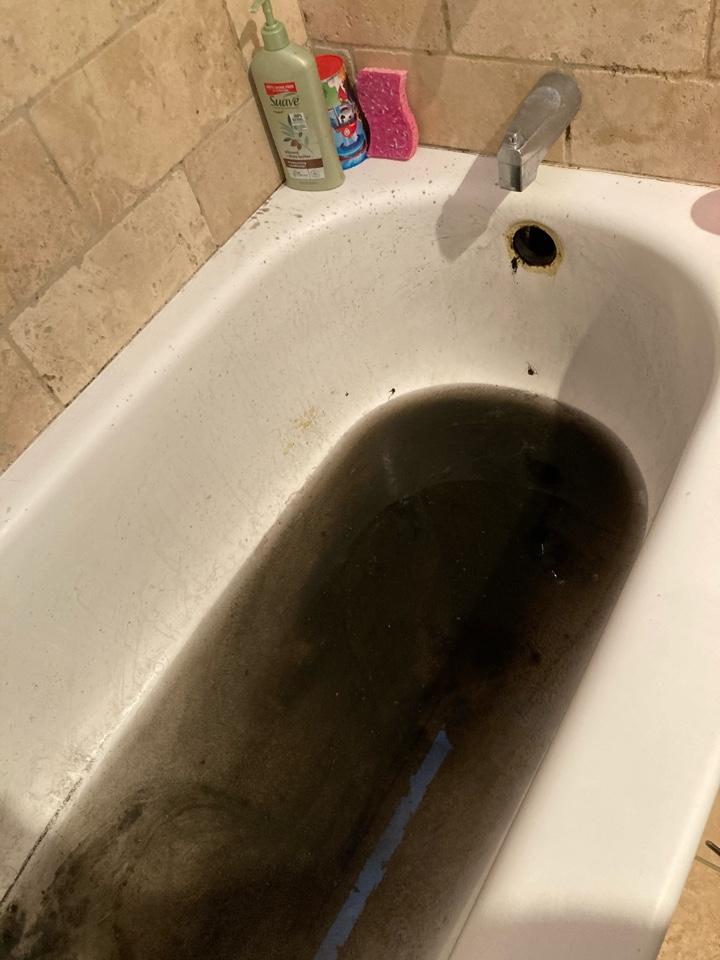 Ventura, CA - Plumber snake tub through overflow to clear blockage.