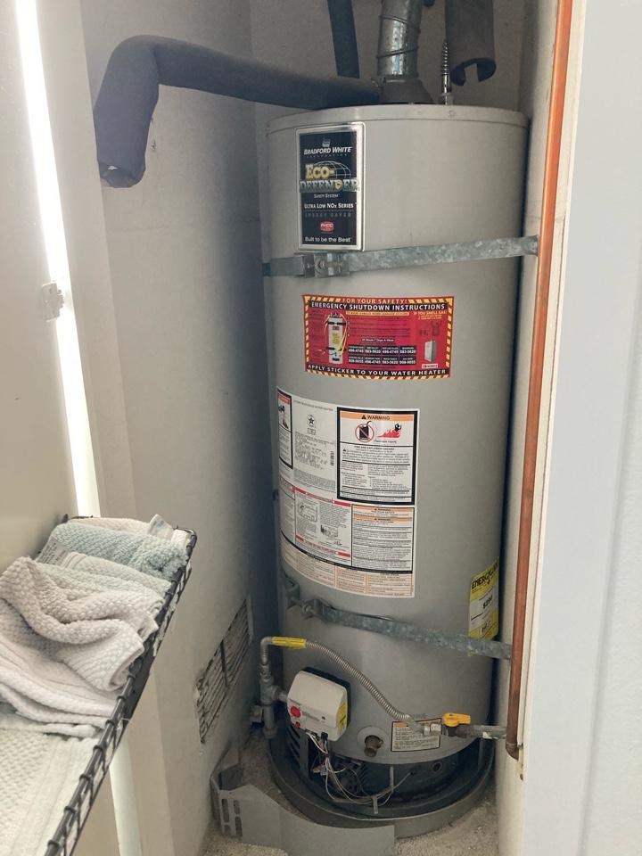 Moorpark, CA - Plumber relit water heater.