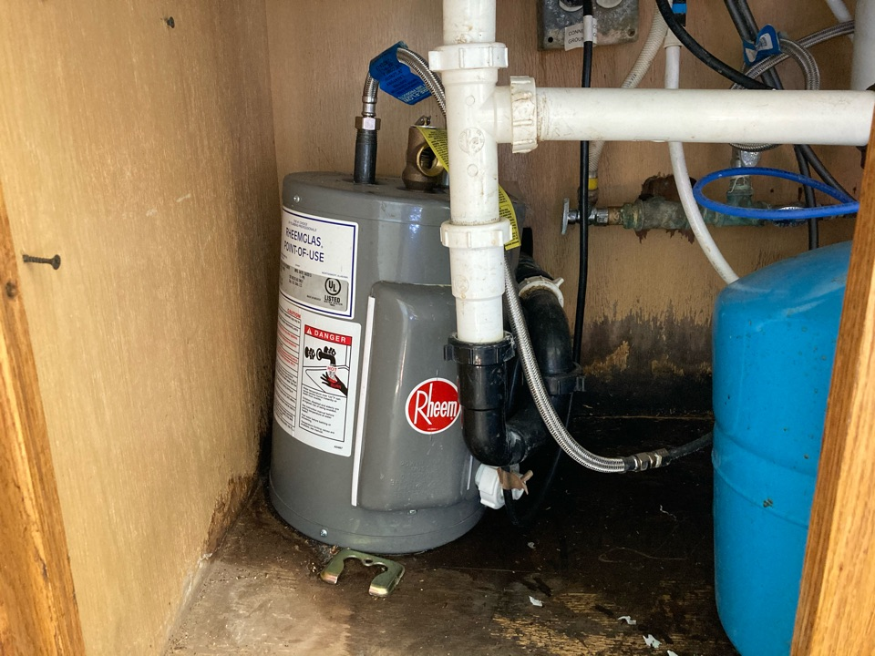 Ventura, CA - Plumber removed old leaking water heater.