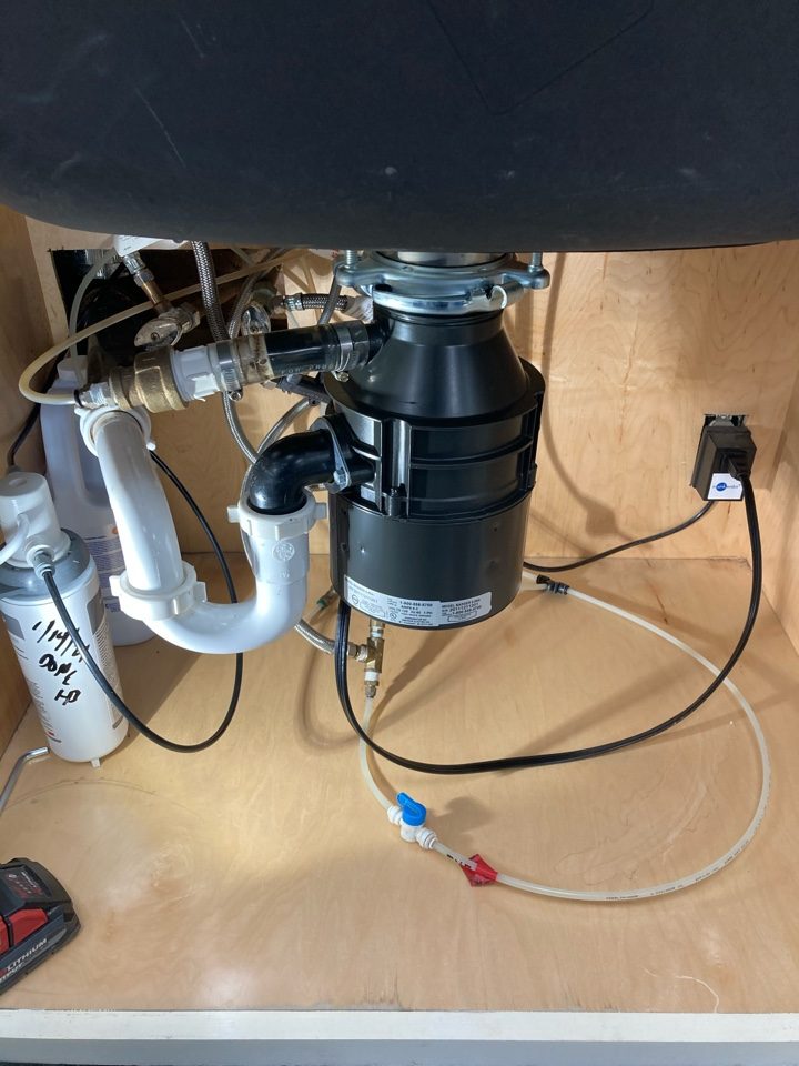 Carpinteria, CA - Plumber installed new garbage disposal and preformed urinal auger to clear drain.