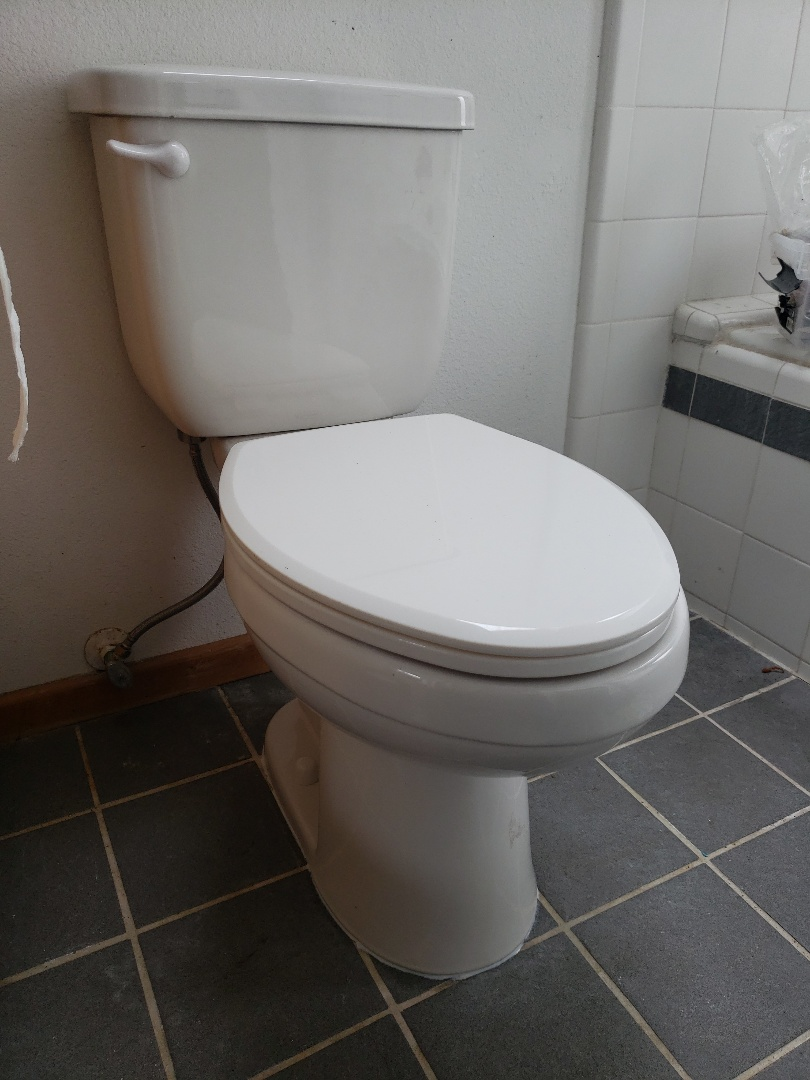Santa Cruz, CA - Resetting toilet with new connections.