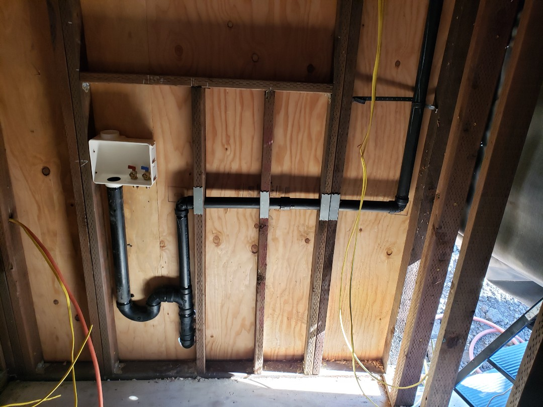 New laundry drain line installation.
