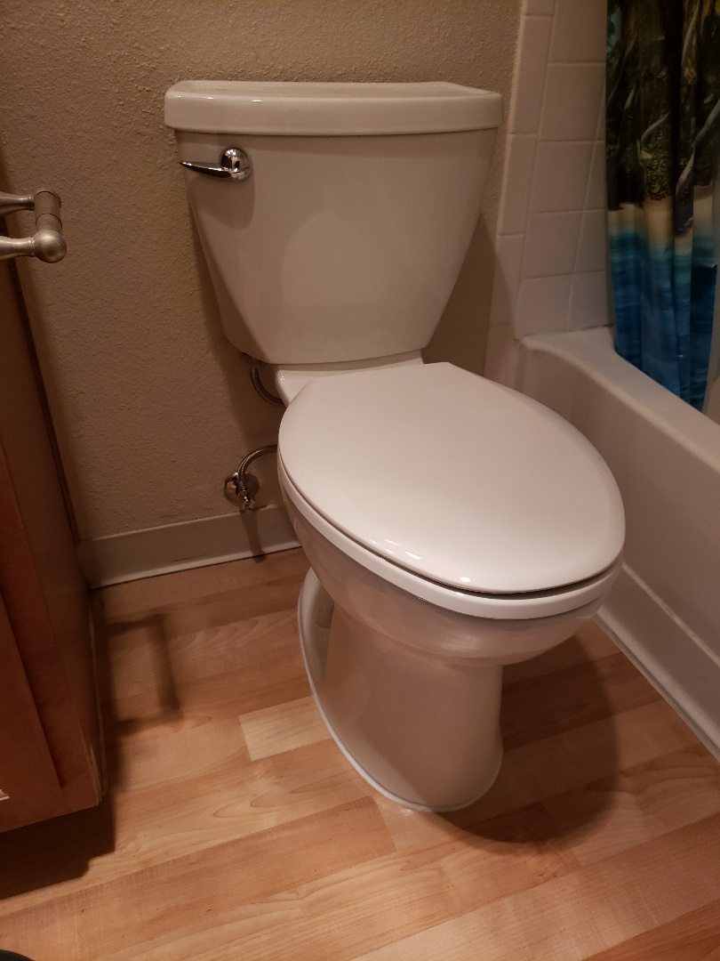 New low flow toilet installation by Expert Plumbing.