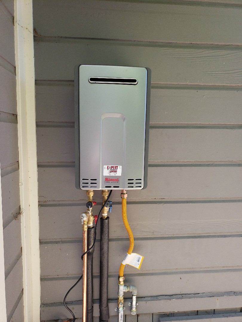 New Tankless water heater installation by Expert Plumbing.