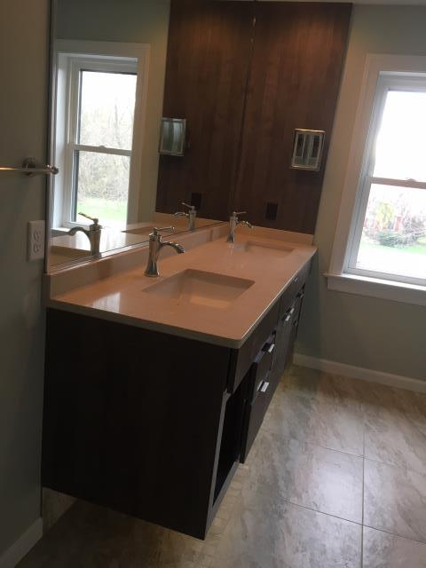 Malvern, PA - Modern, floating, double sink vanity with textured wood grain finish and Caesarstone quartz countertops.
