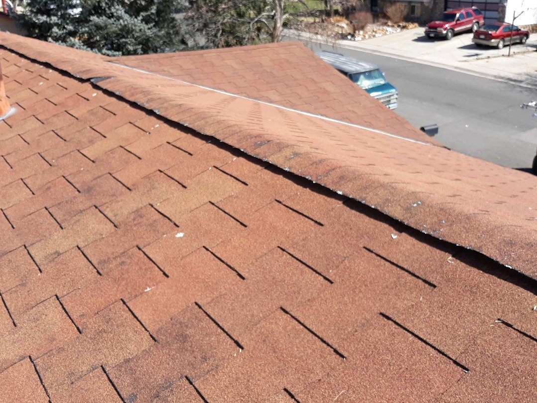 Arvada, CO - Inspection of T lock asphalt shingle roof system reviews substantial hail damage and minor wind damage to north and west facing slopes. Will be recommending full GAF system replacement based on current roofing material being obsolete