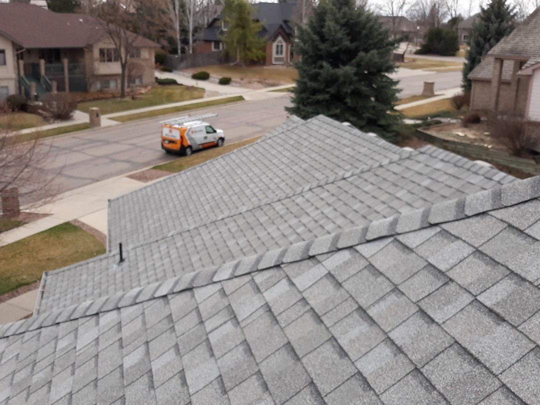 Longmont, CO - Inspection of asphalt dimensional roof system in Rainbow Ridge plan in Longmont CO reveals hail damage to metals and to shingles.  Will be recommending full replacement using GAF roof system