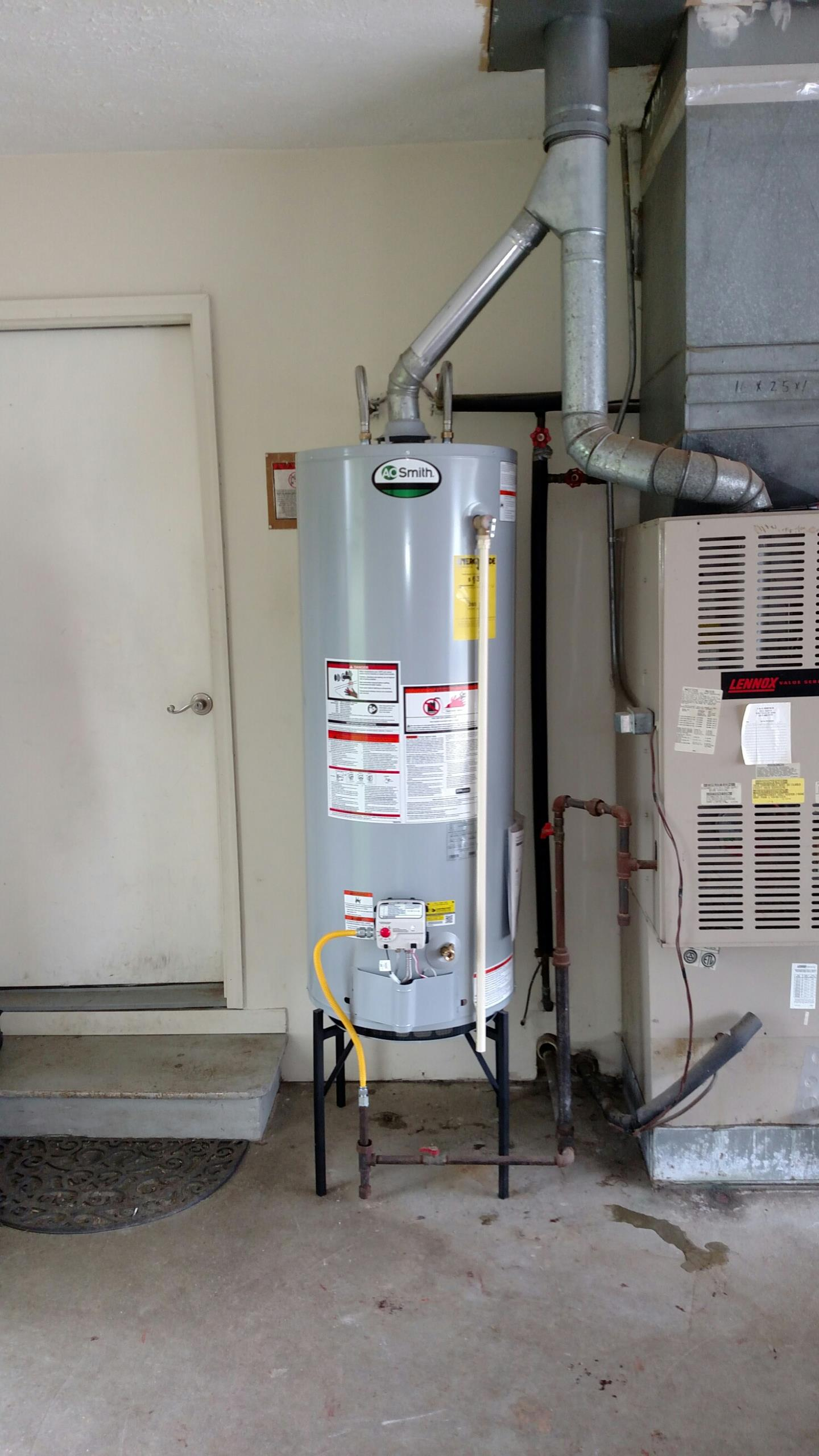Fortville, IN - Drain water heater remove gas line remove glue replace water heater install new gas line install new flu