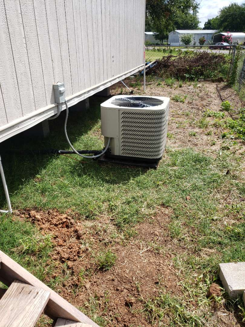 Install air conditioning condenser for new home.